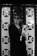 Randall Sharp holding a dog in front of Axis Theater