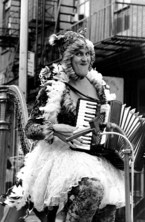 Baby Dee playing an accordian on her harpcycle - copyright Paul Coughlin